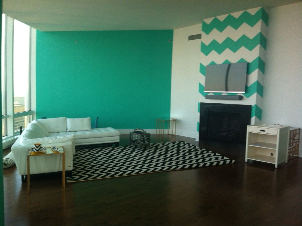 benjamin moore miami green is throughout my house i had the painter create chevron on the wall behind tv designed by chantel gia