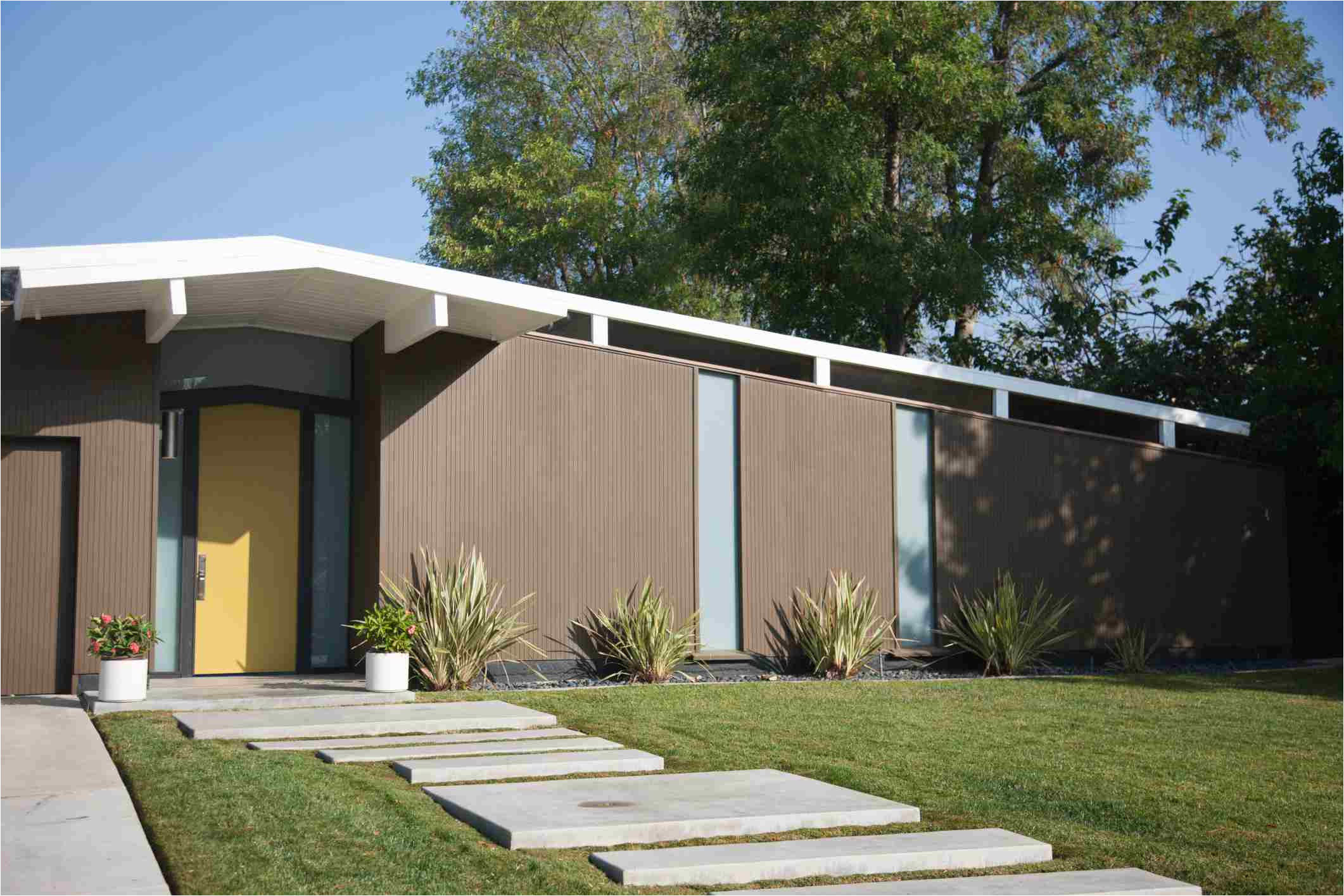 mid century modern house with concrete walkway 168532965