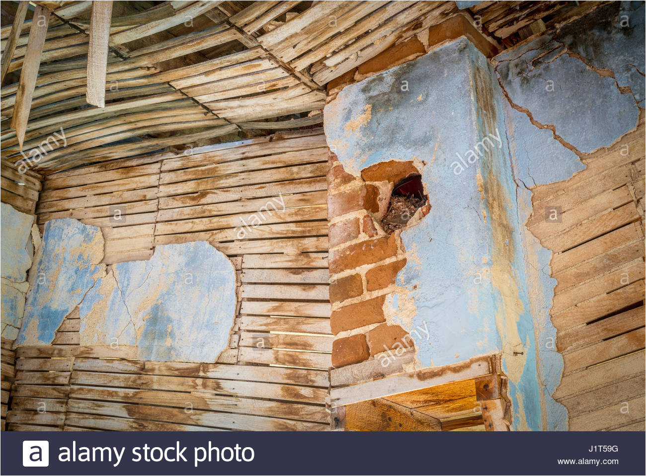 urban decay abstract damaged interior od an abandoned house at an old gold mine in