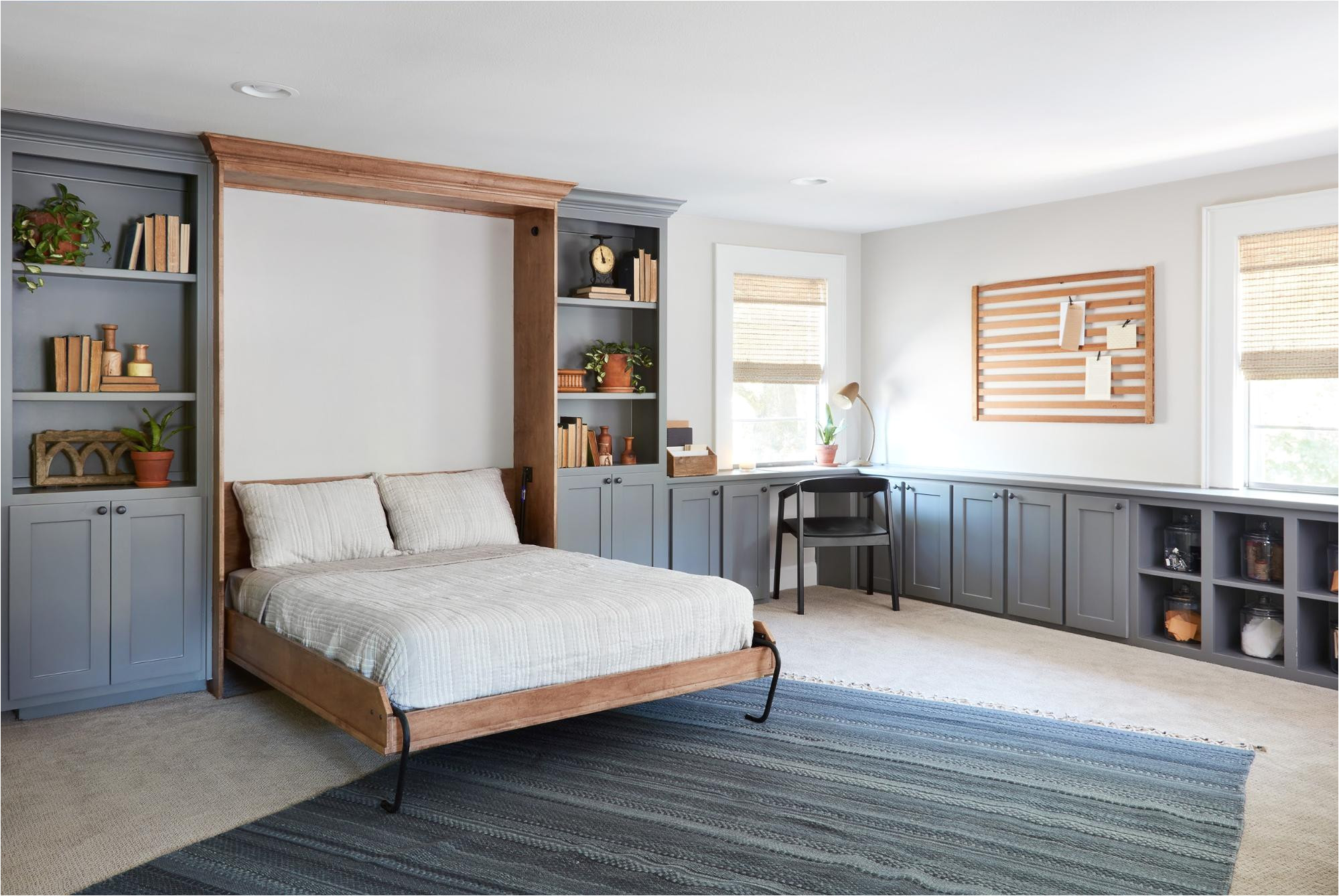 our solution for converting this space to a guest room was to incorporate a murphy bed since this room is in an upstairs loft style area of the home