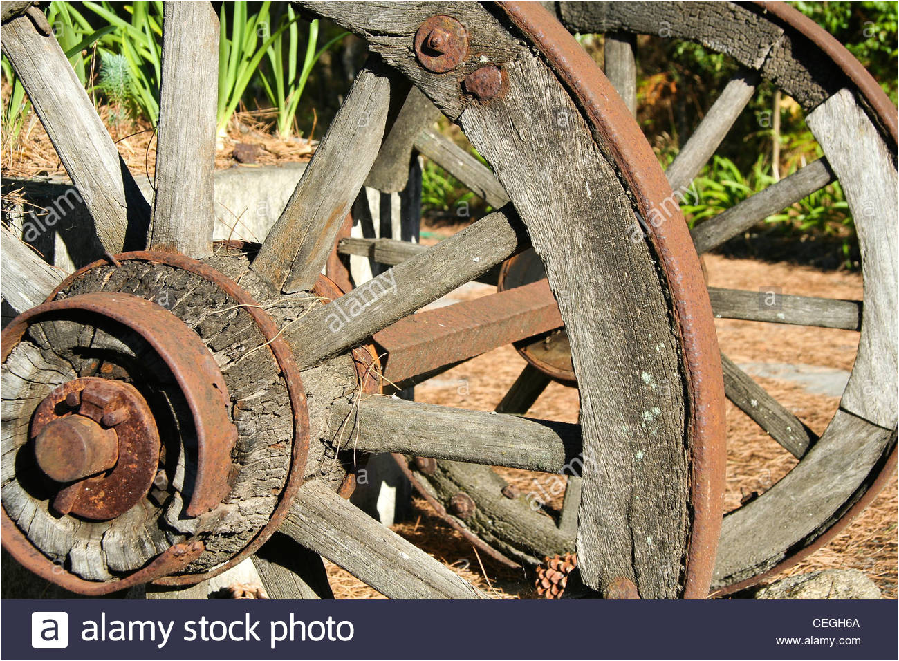 old wood and iron cart wheels stock image