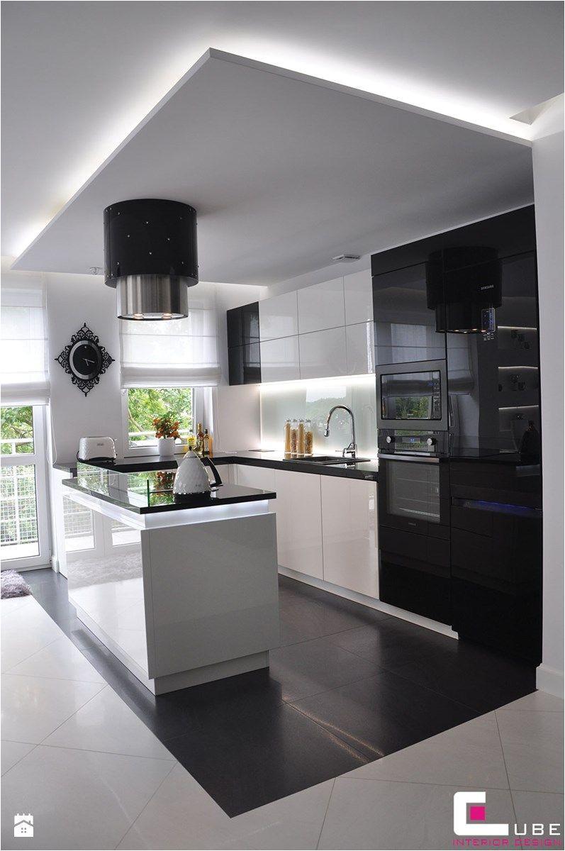 mieszkanie biaa oa a ka warszawa a rednia otwarta kuchnia w ksztaa cie litery l z wyspa styl glamour zdja cie od cube interior design