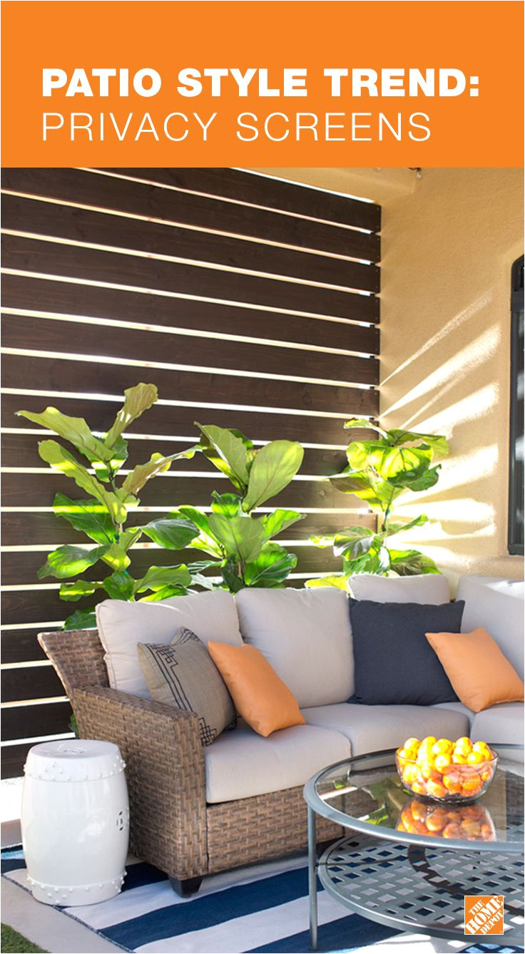 make your patio or porch feel more like a room with a privacy screen this diy slatted privacy screen is both functional and beautiful giving the patio a