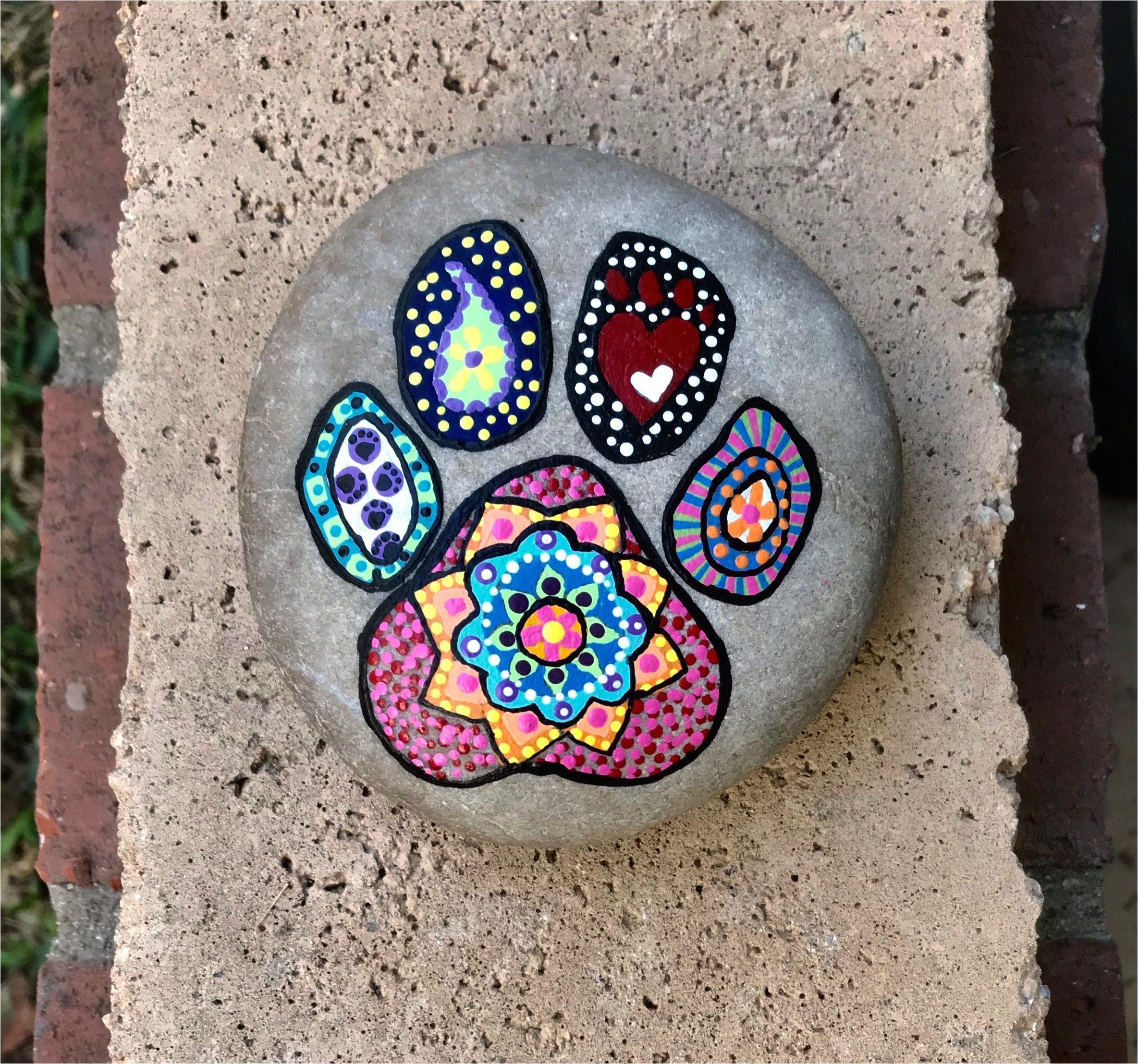 dog paw print hand painted mandala rock by justnaturalelements on etsy