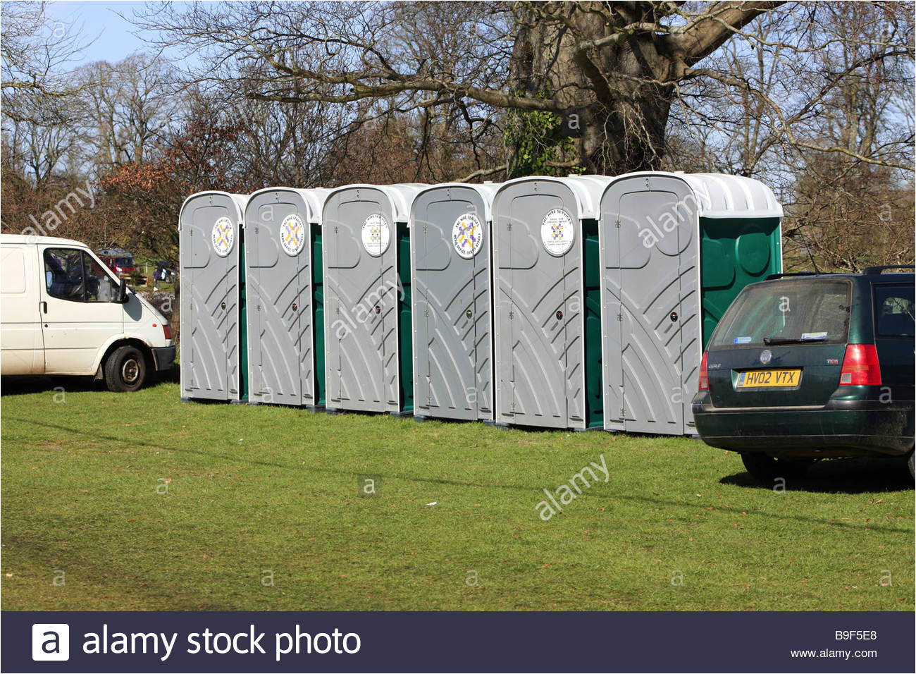 a row of portable loos or portapotty toilets at an outside event stock image