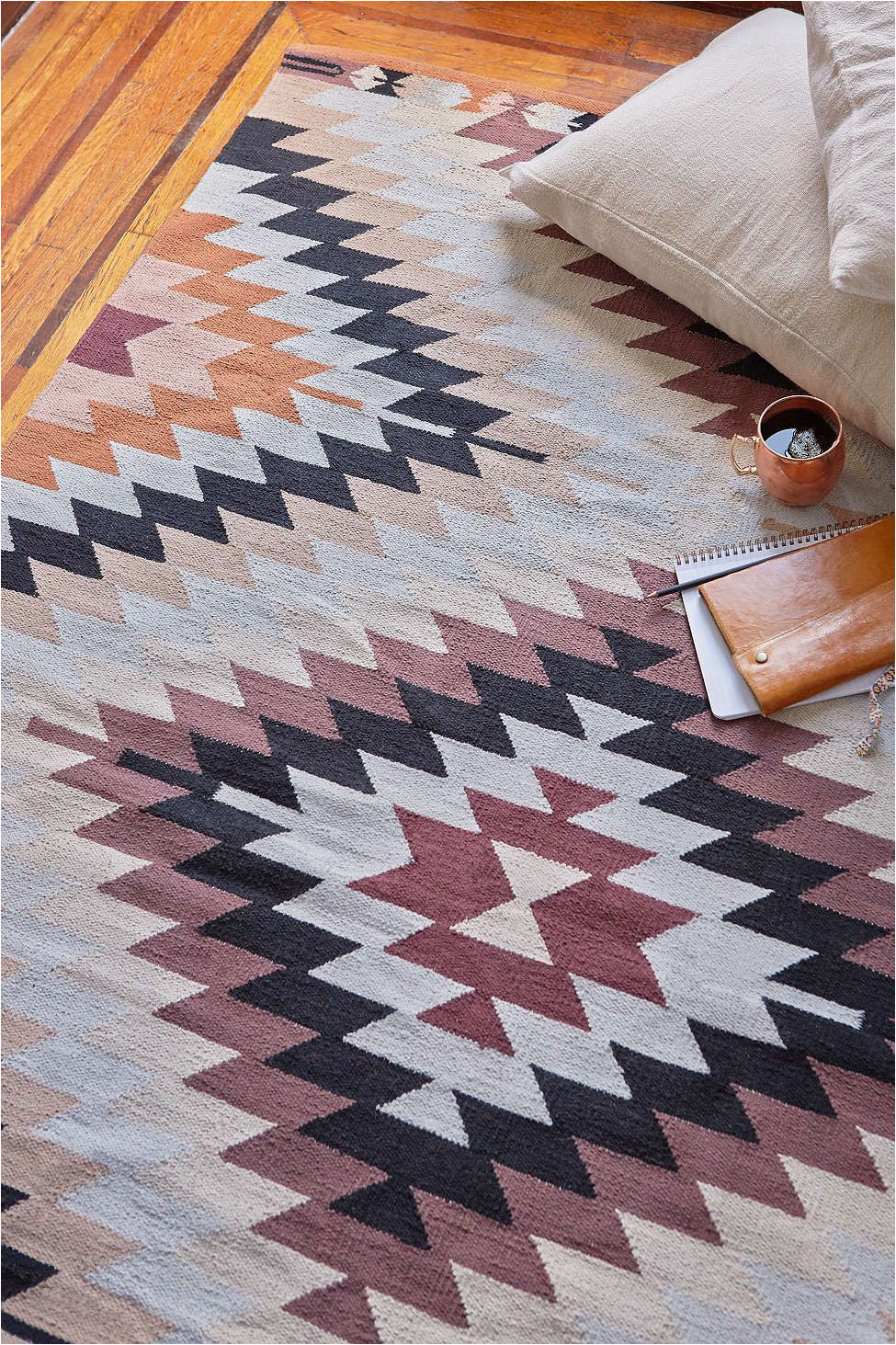 the pattern of this rug combined with these colors makes it the ideal accent piece in any room