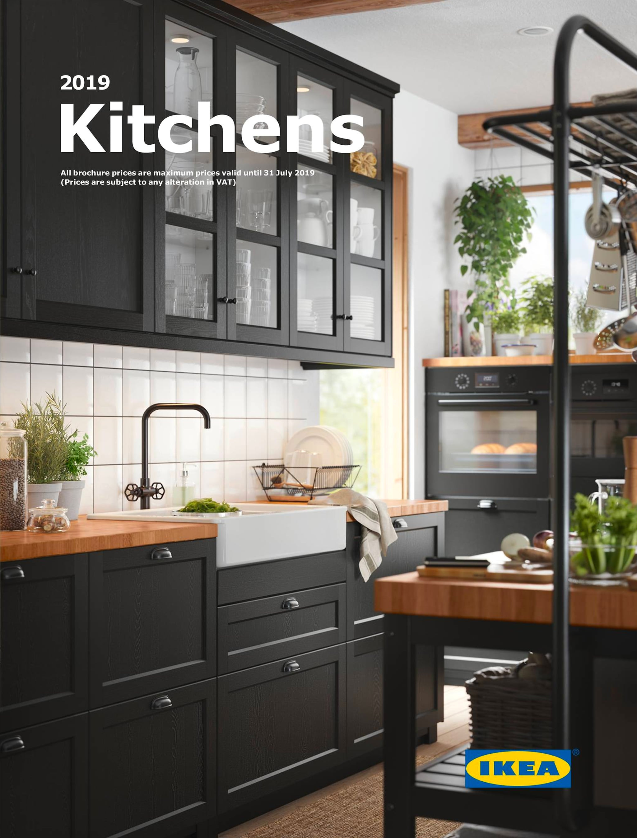 a black traditional kitchen with wooden worktop and a central isle