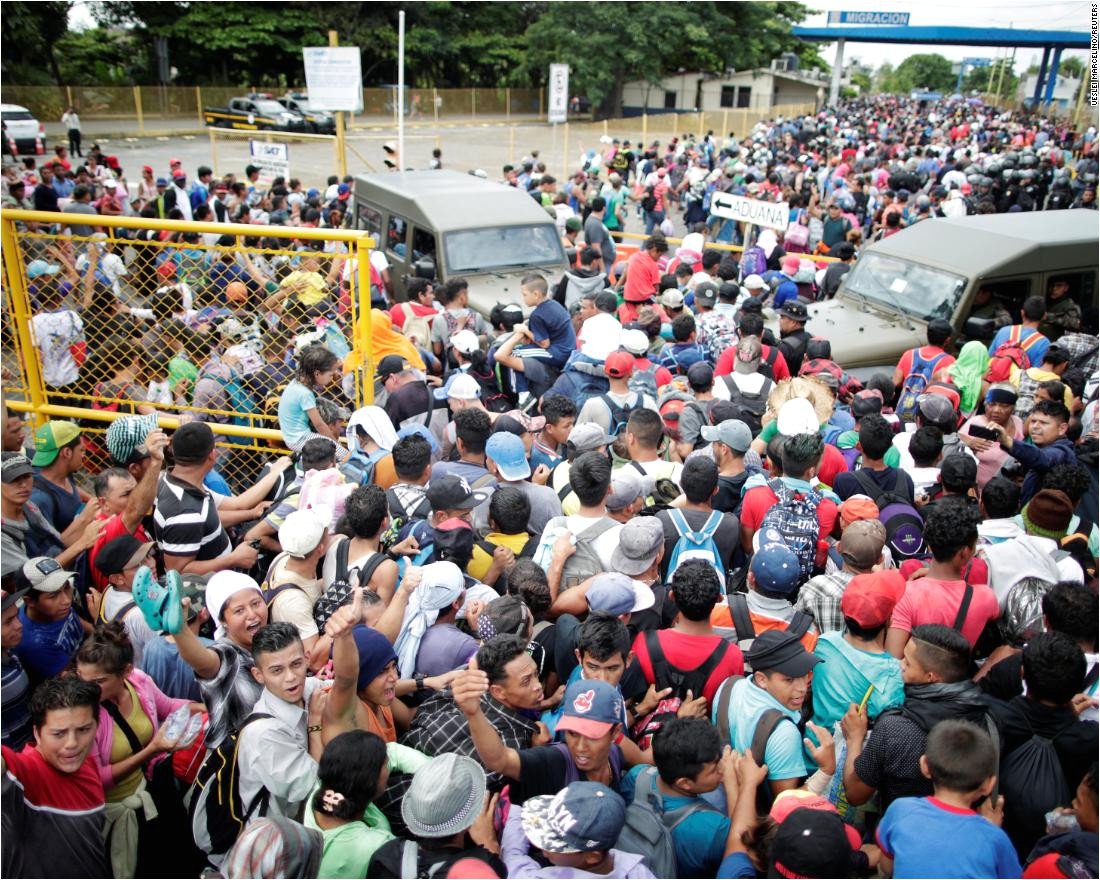 honduran migrants part of a caravan trying to reach the united states storm a