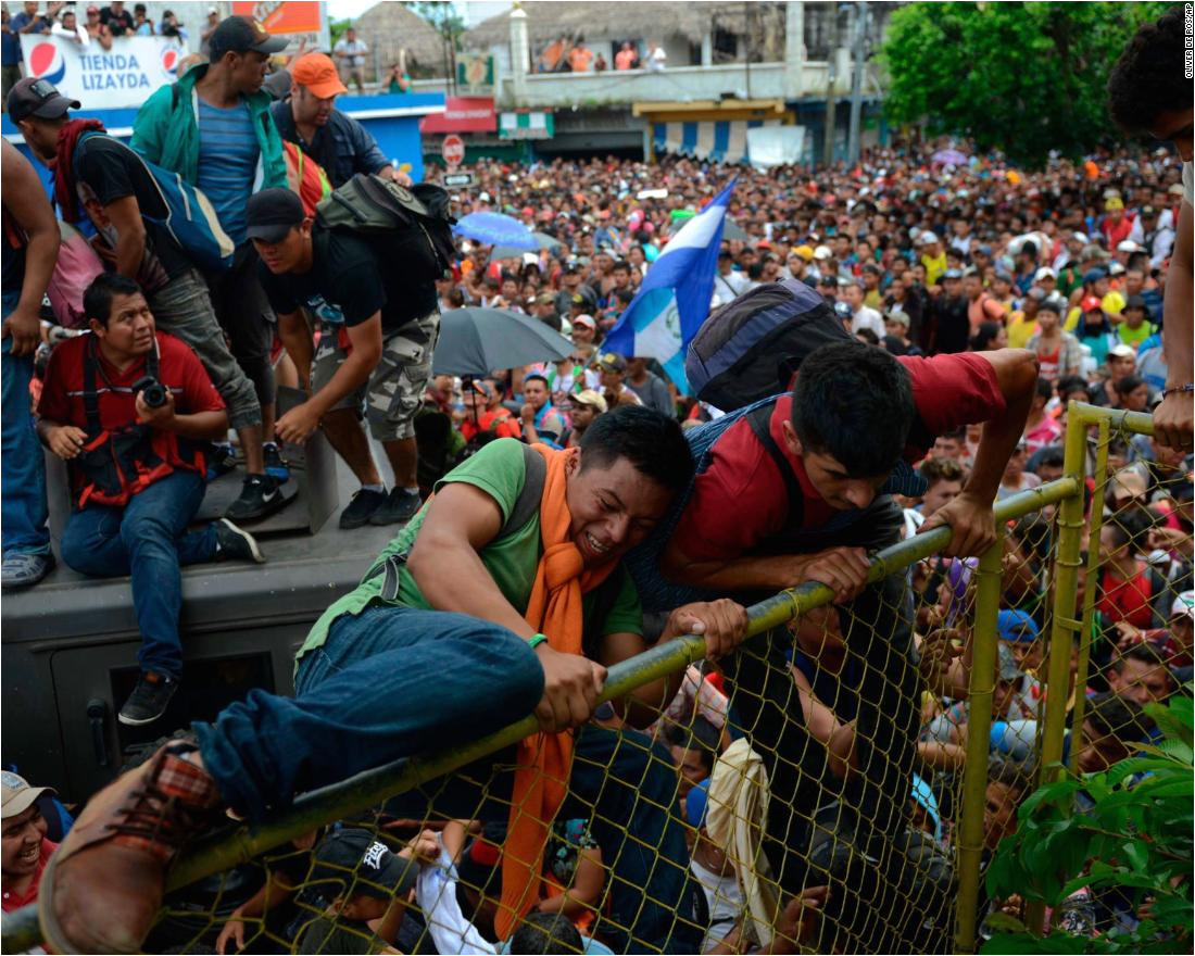 thousands of honduran migrants rush across the border toward mexico in tecun uman guatemala
