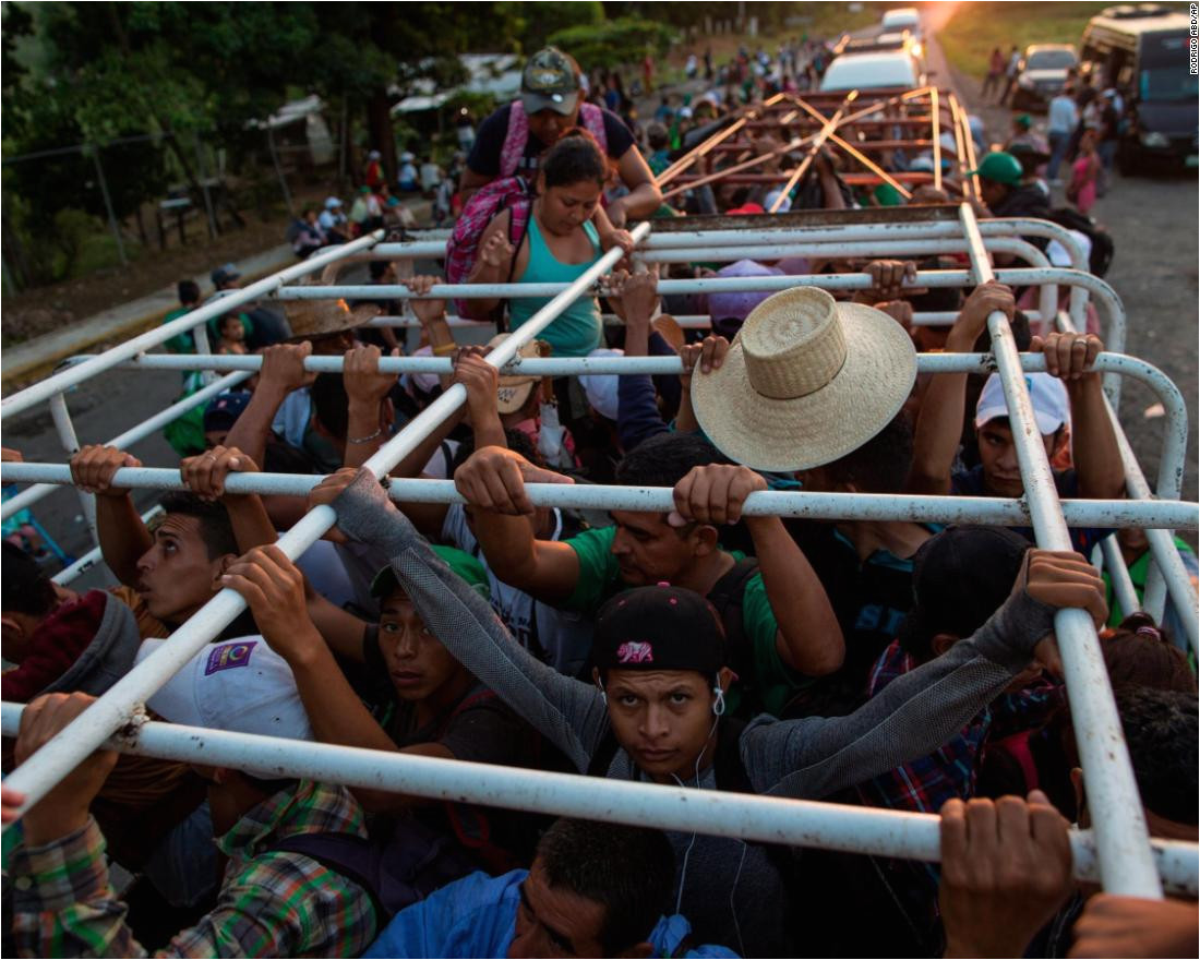 migrants travel on a cattle truck as a thousands strong caravan of central american