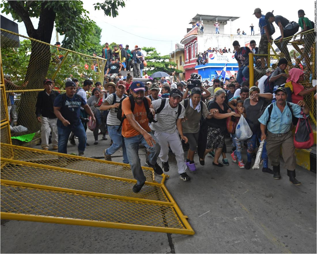 honduran migrants heading in a caravan to the united states rush through the guatemala mexico