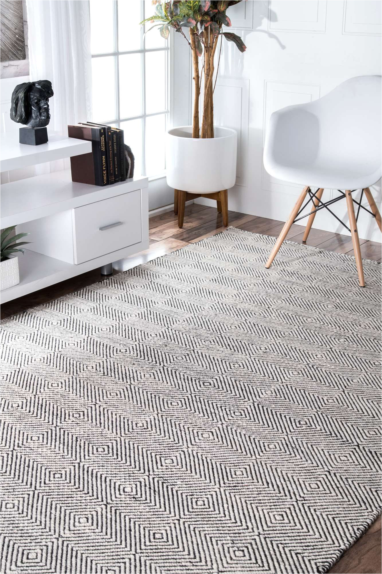 create an urban and chic look with this contemporary hand woven paddle rug that spells quality as well as durability available in subtle colors and