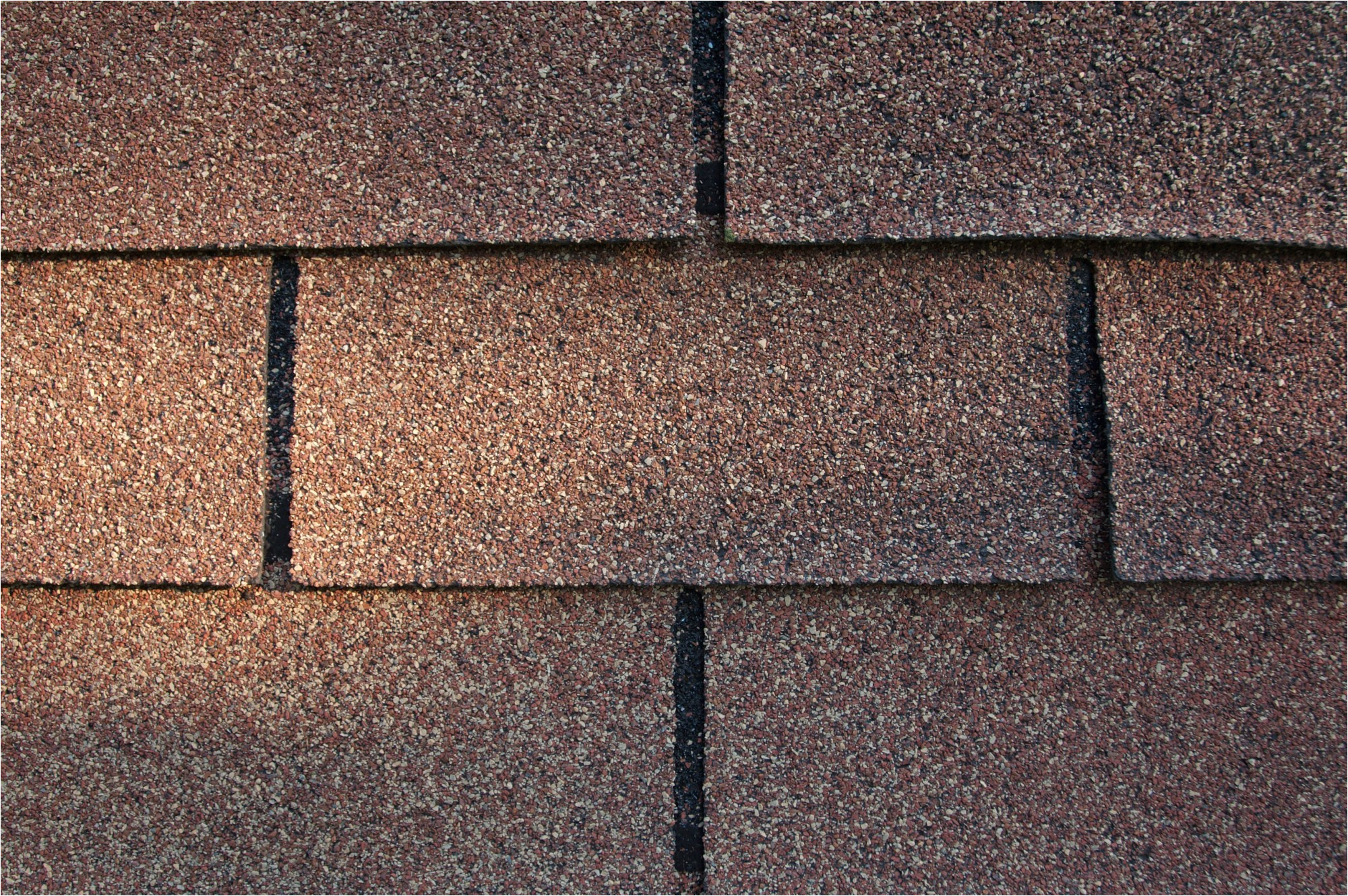 three tab asphalt shingle roofing in good condition