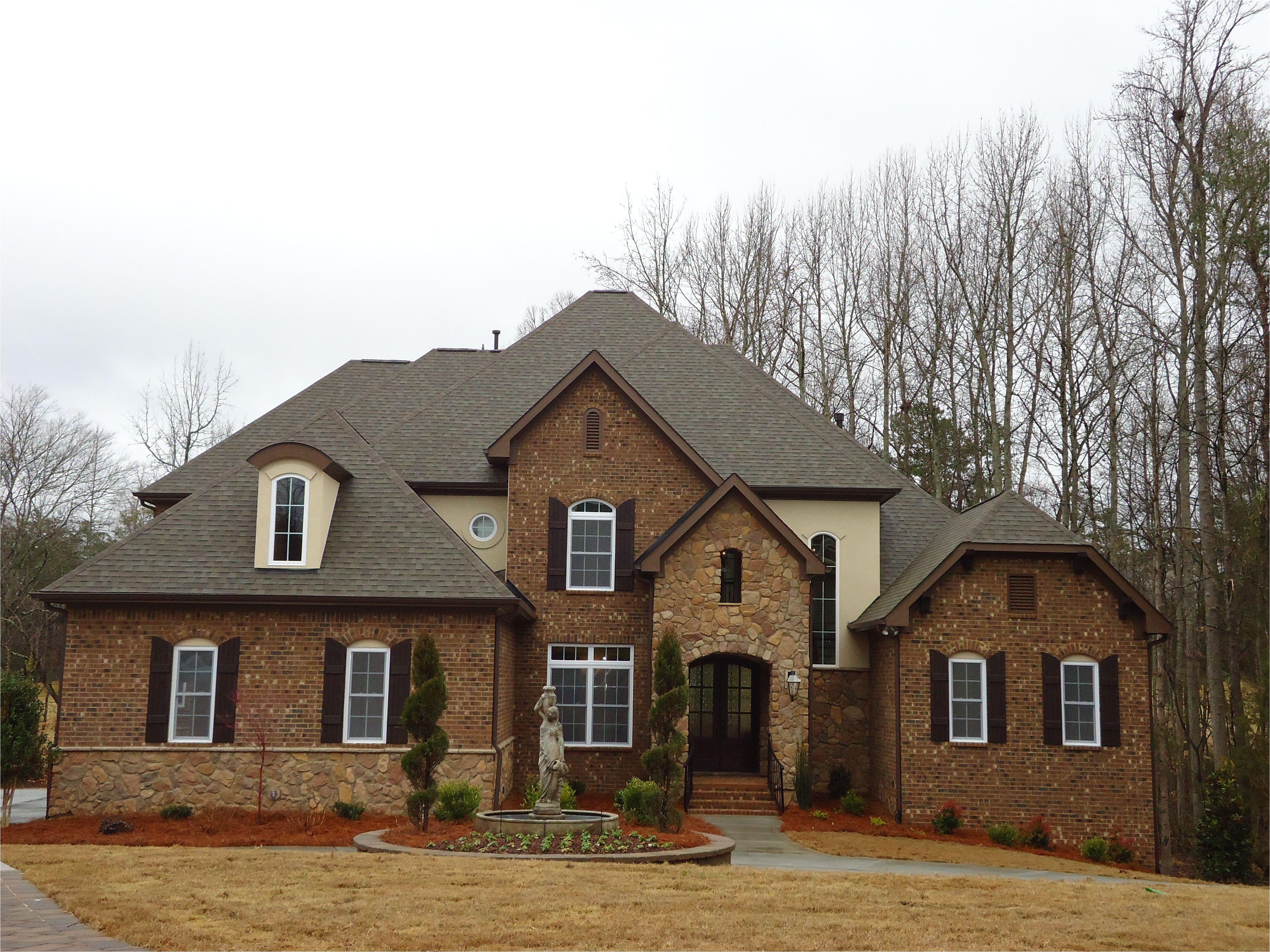 exterior 4 roof owens corning oakridge asphalt shingle driftwood soffits sw6083 sable fascia sw6083 sable stucco paint sw6142 macadamia
