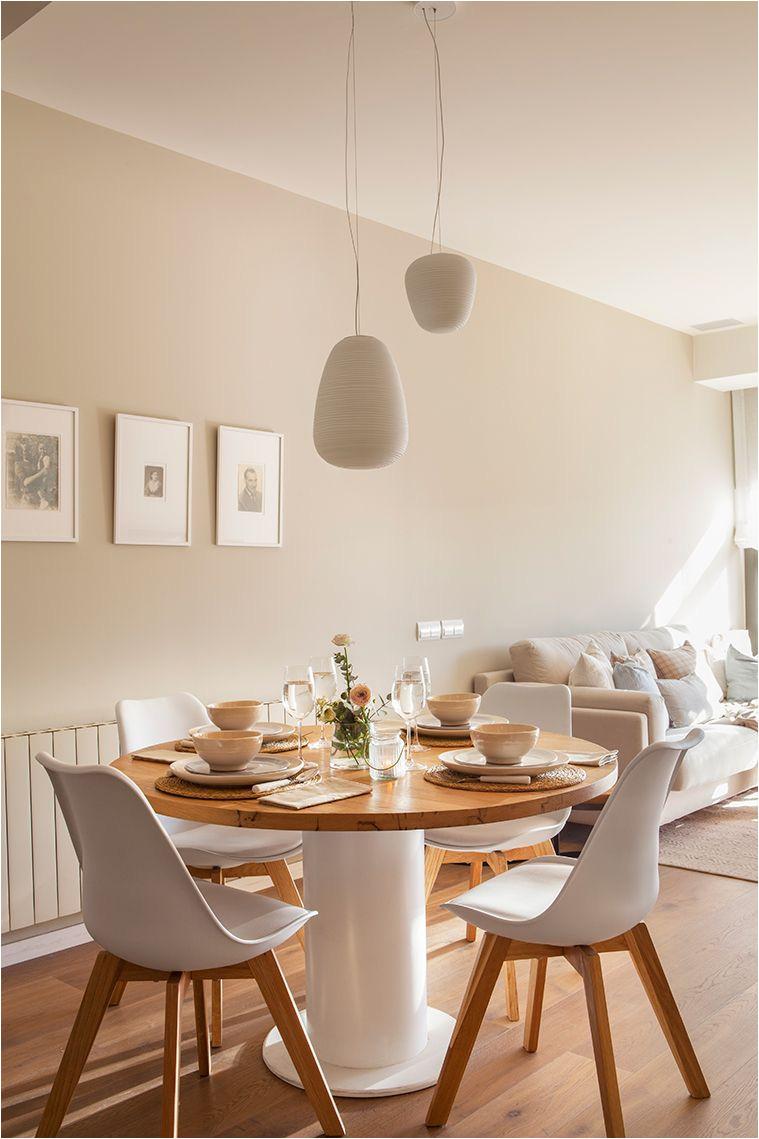comedor pequea o y moderno con mesa redonda y sillas inspiradas en los iconos de la decoracia n en blanco y madera