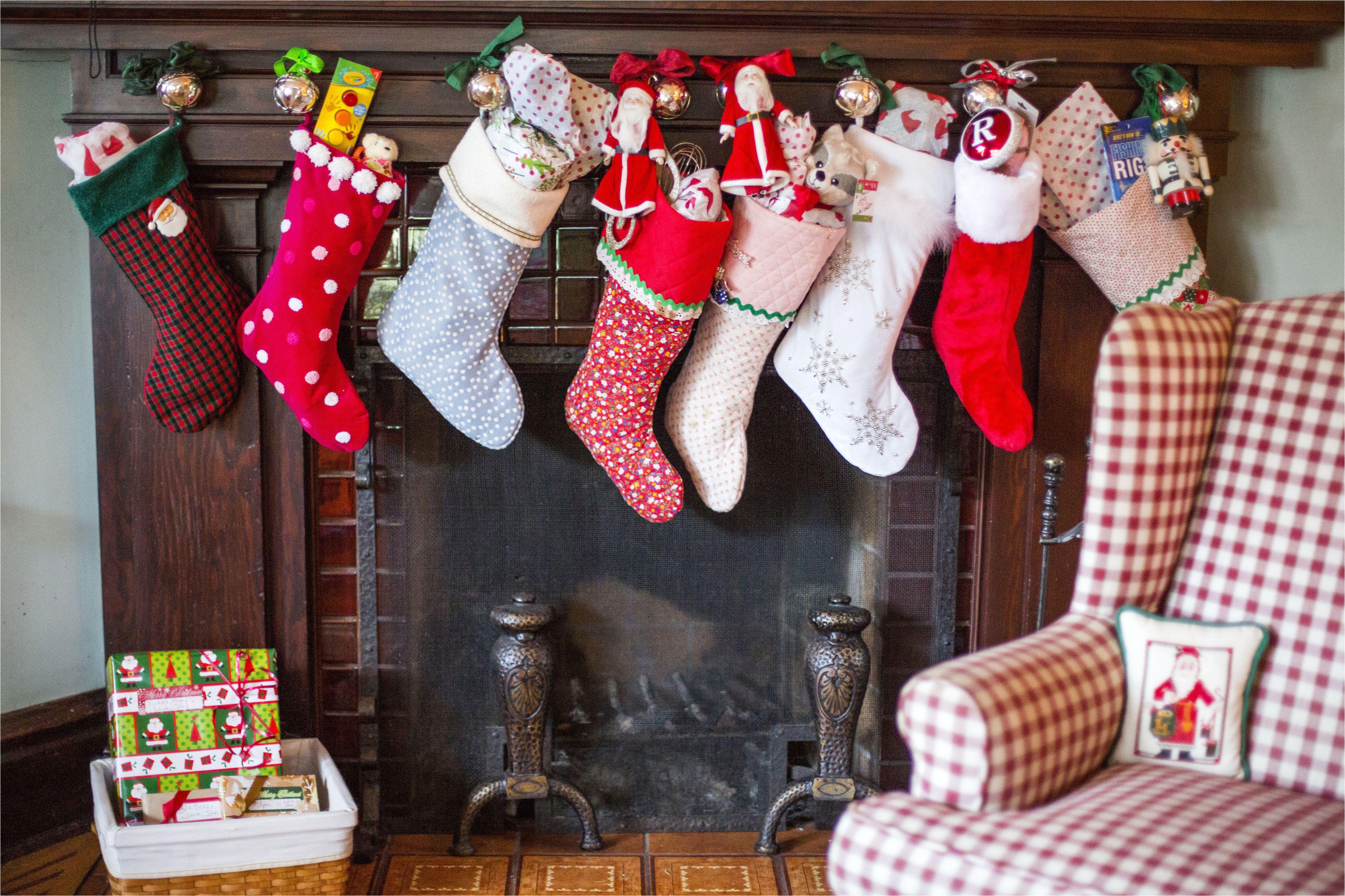 stuffed christmas stockings over fireplace 554370543 59f7502baf5d3a0010de738d jpg