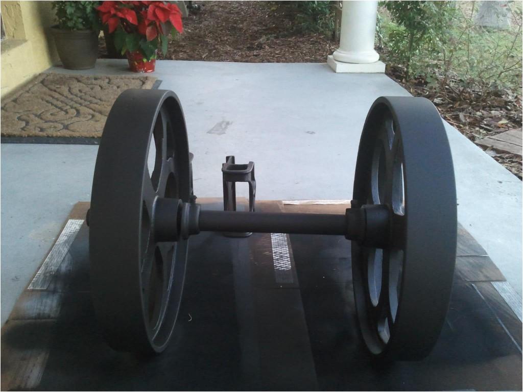 cast iron factory cart wheel painted black