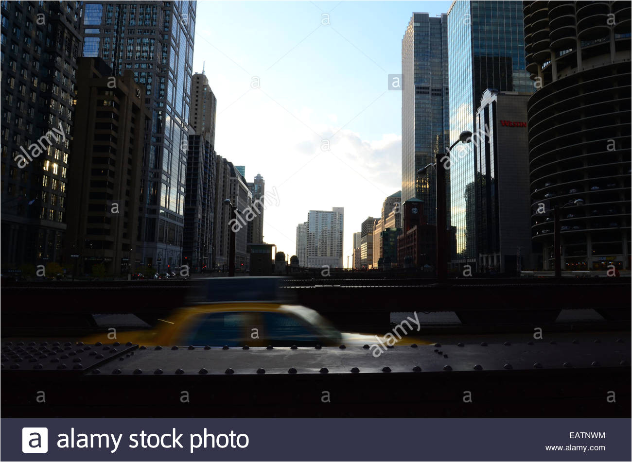 a yellow cab speeds across the north wabash avenue bridge stock image