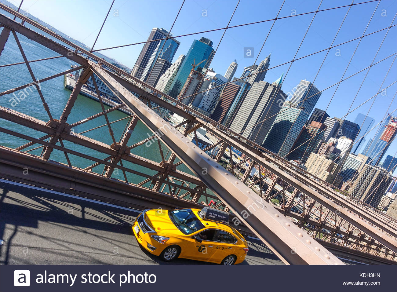 brooklyn bridge roadway with yellow cab new york manhattan united states usa
