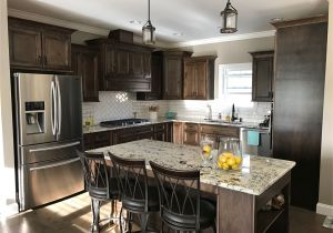 Alaska White Granite with Gray Cabinets Dark Walnut Stained Cabinets Alaska White Granite White Subway
