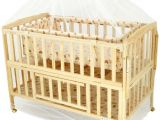 Half Baby Crib attached to Bed Happy Dino Beige Bassinet Buy Happy Dino Beige Bassinet Online at