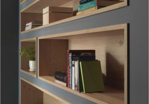 How to Decorate A Half Wall Ledge Built In Bookshelves Lined with Wood Highlight the Displayed Decor