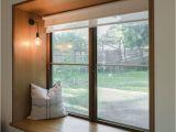 Milgard Windows San Diego Blackbutt Timber Window Seat and Sashless Window by Against the