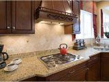 New Venetian Gold Granite and Tile Backsplash New Venetian Gold Granite Grace Style and Stunning