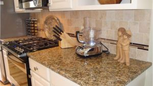 New Venetian Gold Granite with Glass Tile Backsplash New Venetian Gold Granite with Travertine Tile Backsplash