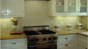 New Venetian Gold Granite with Subway Tile Backsplash New Venetian Gold Design White Subway Tile Backsplash
