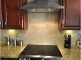 New Venetian Gold Granite with Subway Tile Backsplash New Venetian Gold Granite Countertop with Tile Backsplash