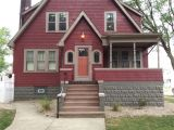 Rhino Shield House Paint Deep Red with Sycamore Tan Sherwin Williams Trim and Burnished