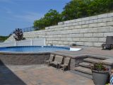 Semi Inground Pools Long island Radiant Semi Inground Round with Pavers Radiant Pools Backyard